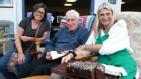 90 year old Robert Hopkins enjoys meeting friendly faces at Hayle Hub free lunch, shown here with Hayle Hub members Jane Haskins (left) and Alison Saunders